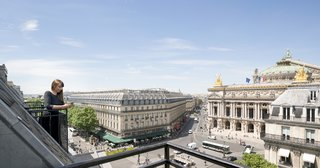 The balcony offers guests and staff incredible views of the Eiffel Tower and Opera Garnier.