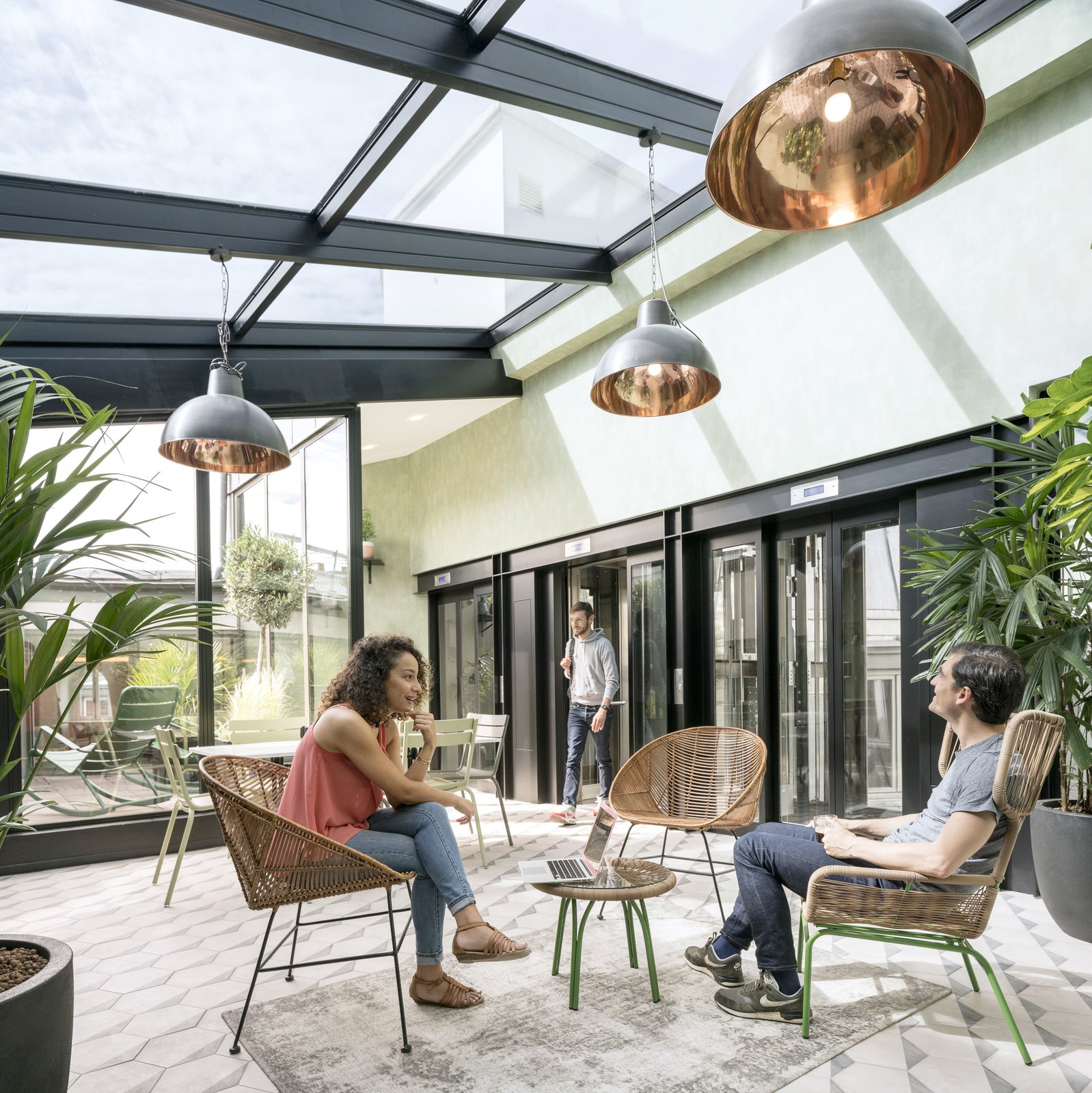 Stepping out of the elevator on the 6th floor, visitors are transported into a luminous, vegetation-filled solarium. Take a Peek Inside Airbnb's New Loft-Inspired Office Space in Paris - Photo 2 of 14