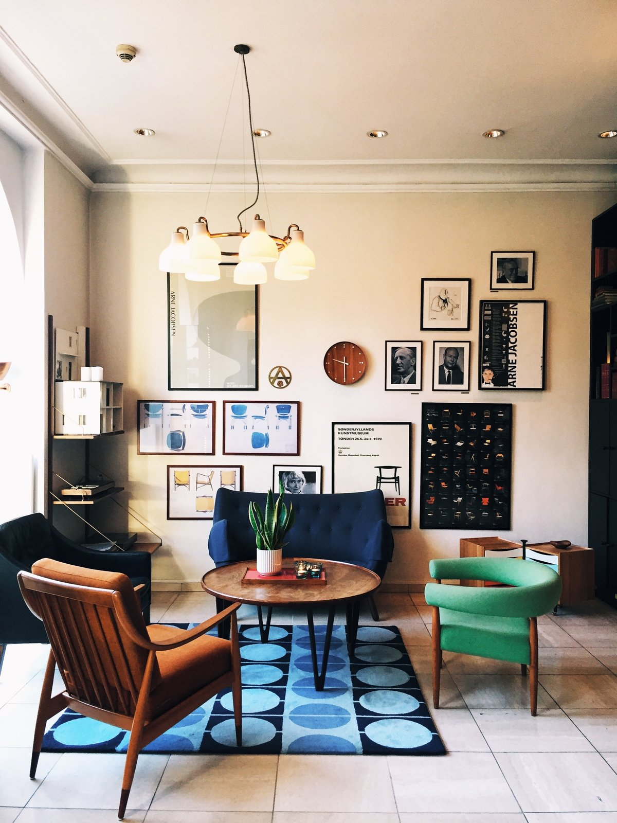 The retro-chic vibe of Copenhagen's Hotel Alexsandra Tagged: Living Room, Chair, Sofa, Coffee Tables, Shelves, Storage, and Pendant Lighting.  Photo 2 of 9 in Get Your Fix of Midcentury Scandinavian Design at This Copenhagen Hotel
