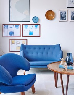 Get Your Fix of Midcentury Scandinavian Design at This Copenhagen Hotel - Photo 2 of 8 - The mood is set with a Poet sofa and Pelican chair by Finn Juhl, vintage prints, and a coffee table from Tove and Edvard Kindt-Larsen.