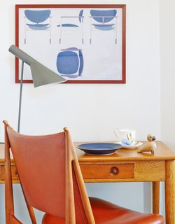 Get Your Fix of Midcentury Scandinavian Design at This Copenhagen Hotel - Photo 5 of 8 - Finn Juhl's Egyptian chair is paired with a Lady Writing Table by Hans J. Wegner. The desk lamp is by Arne Jacobsen.