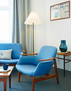 Get Your Fix of Midcentury Scandinavian Design at This Copenhagen Hotel - Photo 6 of 8 - The Finn Juhl Deluxe Room boasts a Finn Juhl NV 53 Chair and NV 53 Sofa.