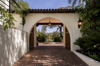 Just Listed at $4M, This Spanish Colonial Revival in Southern California Promises Resort-Like Living - Photo 1 of 8 - Historic charm abounds throughout the property with terracotta tiled arches and white stucco walls.