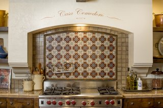 Just Listed at $4M, This Spanish Colonial Revival in Southern California Promises Resort-Like Living - Photo 3 of 8 - Hand-painted tiles make for a charming backsplash. The kitchen was designed in collaboration with Fleetwood Joiner and & Associates to closely match the style of the home.