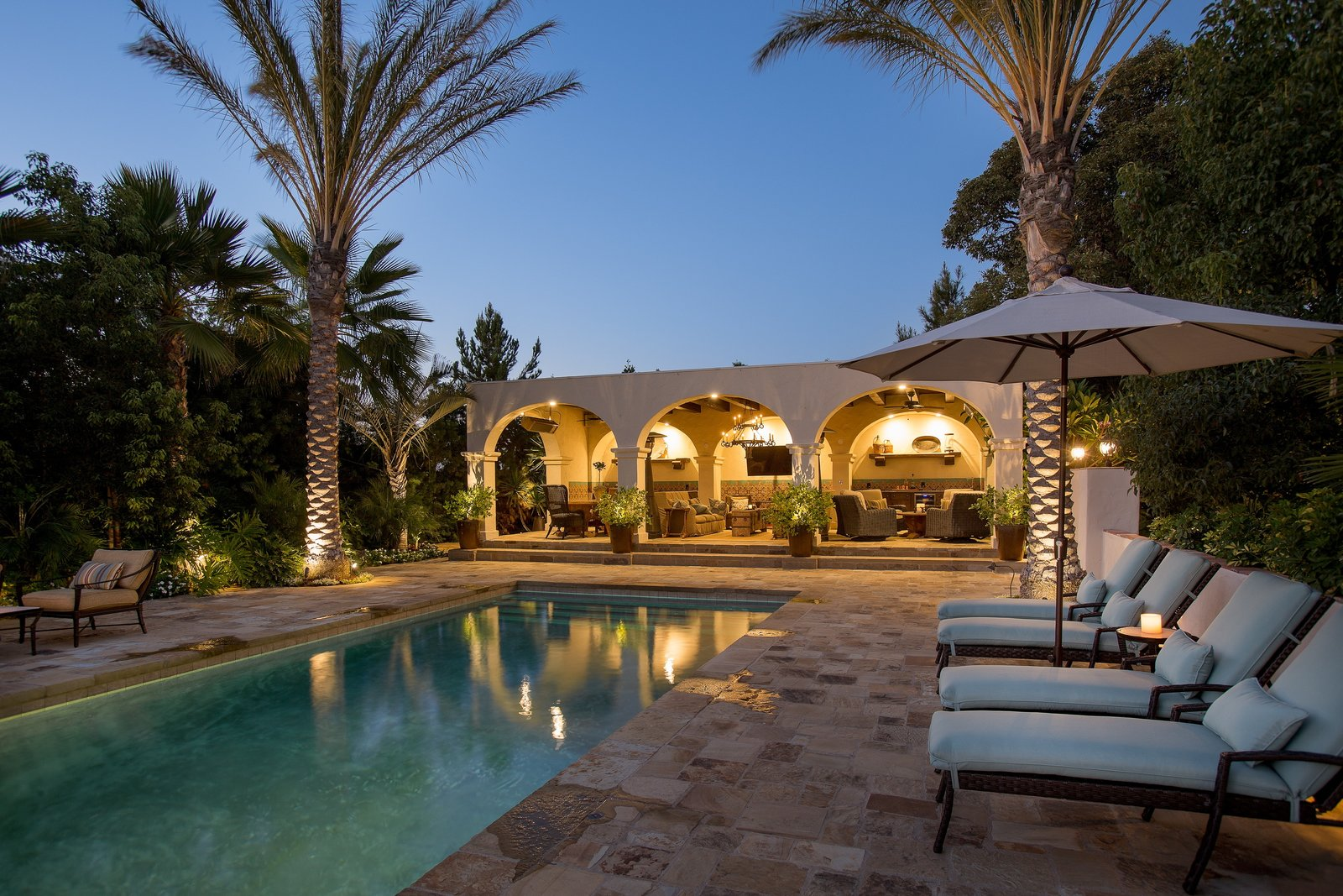 The most breathtaking features of Casa Comodoro are the custom pool and loggia area designed by Marc Appleton and Paul Williger. The architects have truly mastered the integration of the original architecture with modern updates and have created a space perfect for enjoying Southern Californian outdoor entertaining.  Photo 8 of 9 in Just Listed at $4M, This Spanish Colonial Revival in Southern California Promises Resort-Like Living