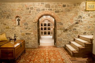 Just Listed at $4M, This Spanish Colonial Revival in Southern California Promises Resort-Like Living - Photo 8 of 8 - The wine cellar was formerly a speakeasy. Crafted from imported Italian brick, it has a 360-bottle capacity and features a completely dedicated thermostat and humidifier with a hand-forged, 1000-pound custom door.