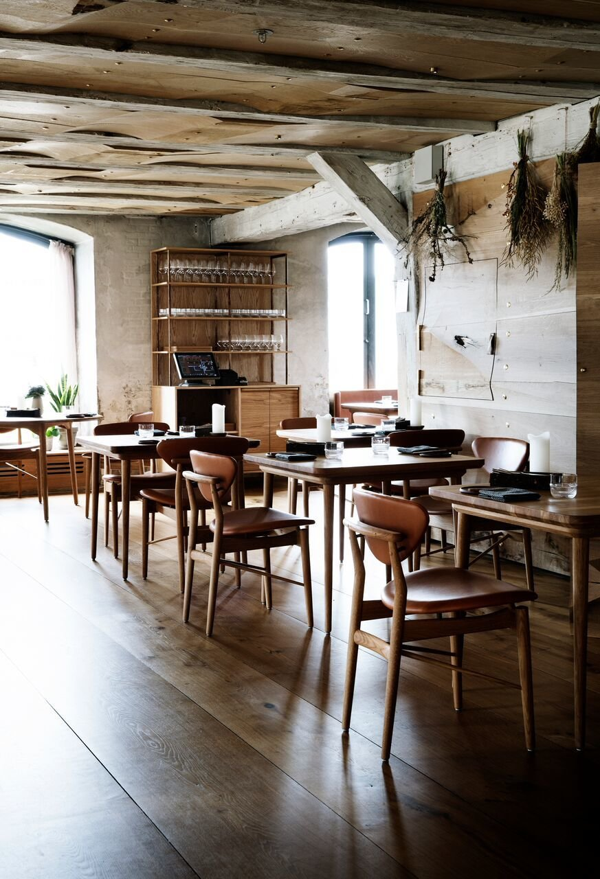 Upon entering the restaurant, guests are met with a warm oak floor, which is in contrast to the rough texture of the original stone walls.  Photo 3 of 10 in Snøhetta Designs the Interiors of Barr, the Noma Group's New  Copenhagen Restaurant