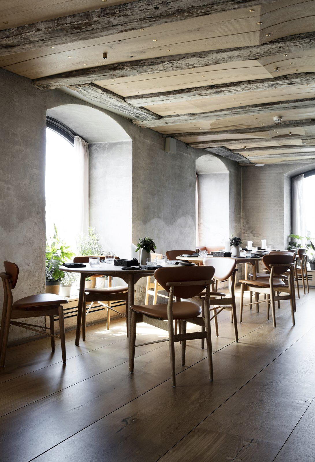 The ceiling is alternately composed of the original ceiling beams and new, sculpted wooden planks, which are embedded with brass details that reflect micro spots of light. Snøhetta Designs the Interiors of Barr, the Noma Group's New  Copenhagen Restaurant - Photo 5 of 10