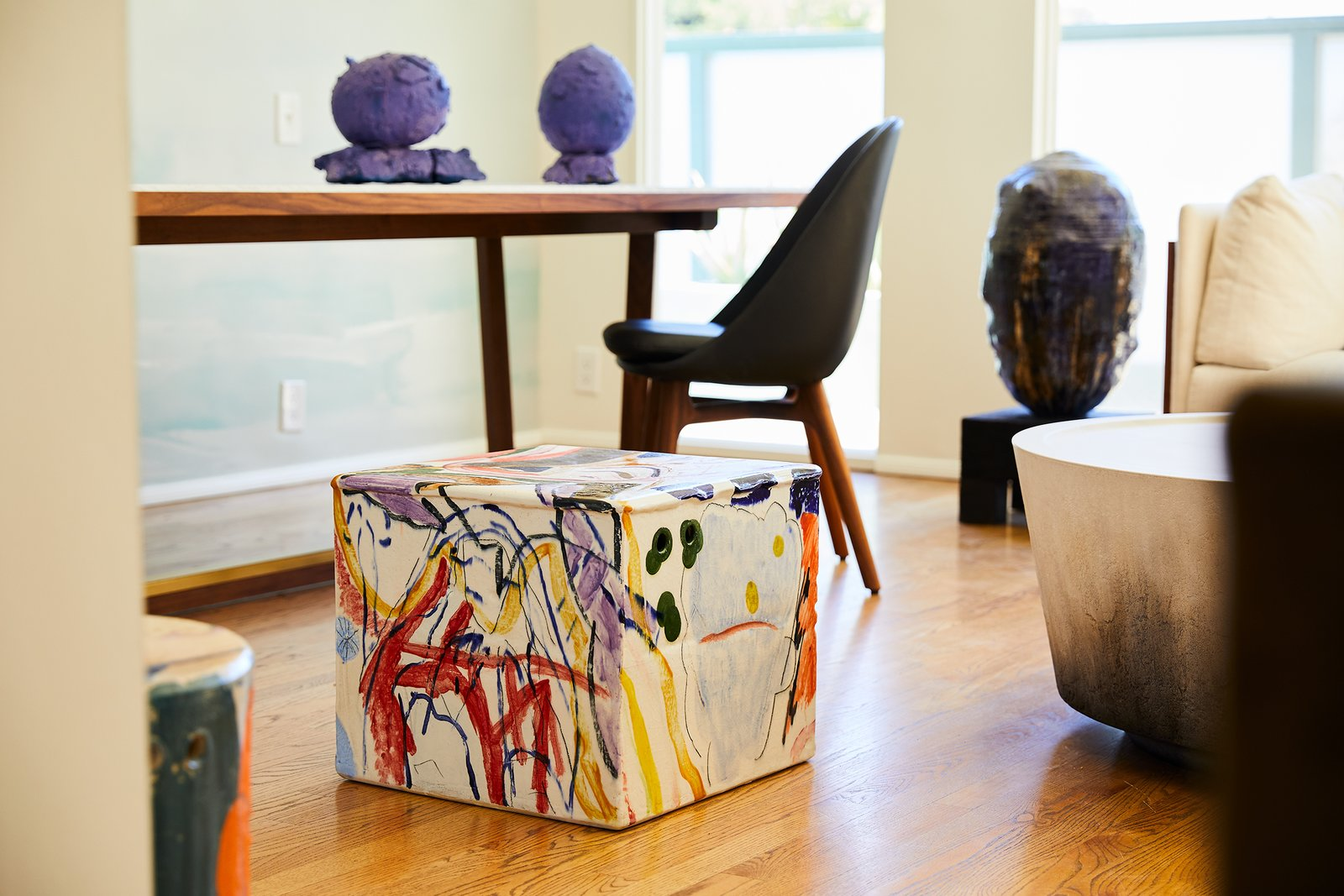 Each piece begins with a wheel thrown or hand built ceramic form, he then spontaneously, paints the work—inspired by his mood, daily events, his surrounding environment and even the piece itself.