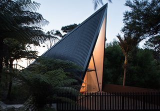 "Stay in a Tent-Inspired A-Frame Cabin in the New Zealand Rain Forest - Photo 7 of 7 - The front deck was designed to ""fan out""—giving the illusion of a shadow cast by the A-frame structure."
