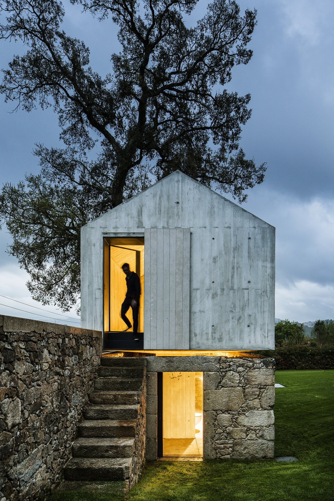 AZO Sequeira Arquitectos Associados transformed this derelict stone and wood backyard dovecoat located in Soutelo, Portugal, into a magical and minimalist concrete children's playhouse complete with a separate level for showers to compliment their client's backyard swimming pool.  Photo 6 of 17 in A New Book Examines the Art of Breathing Life Into Forgotten Architecture