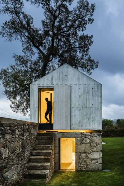 AZO Sequeira Arquitectos Associados transformed this derelict stone and wood backyard dovecoat located in Soutelo, Portugal, into a magical and minimalist concrete children's playhouse complete with a separate level for showers to compliment their client's backyard swimming pool.