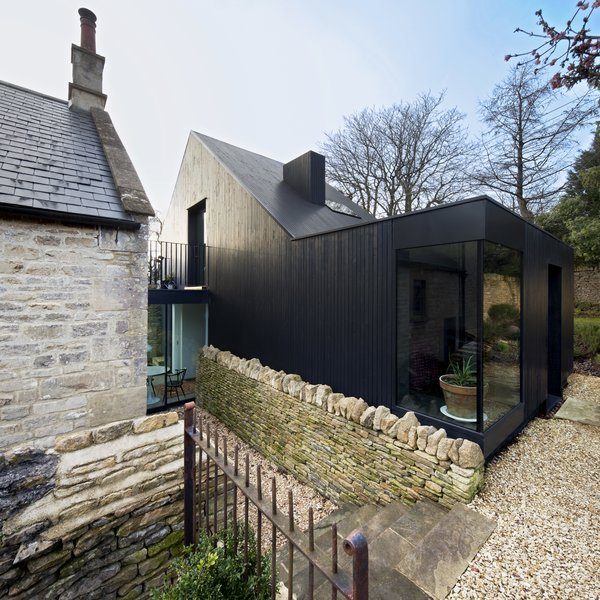 To complement this renovation for a Bath stone and slate Baptist church from 1867 in Wiltshire, UK,   Jonathan Tuckey Design used blackened timber  as a direct reference to the tin tabernacle churches, which are a vernacular type of the rural West Country part of England to the southwest of London.