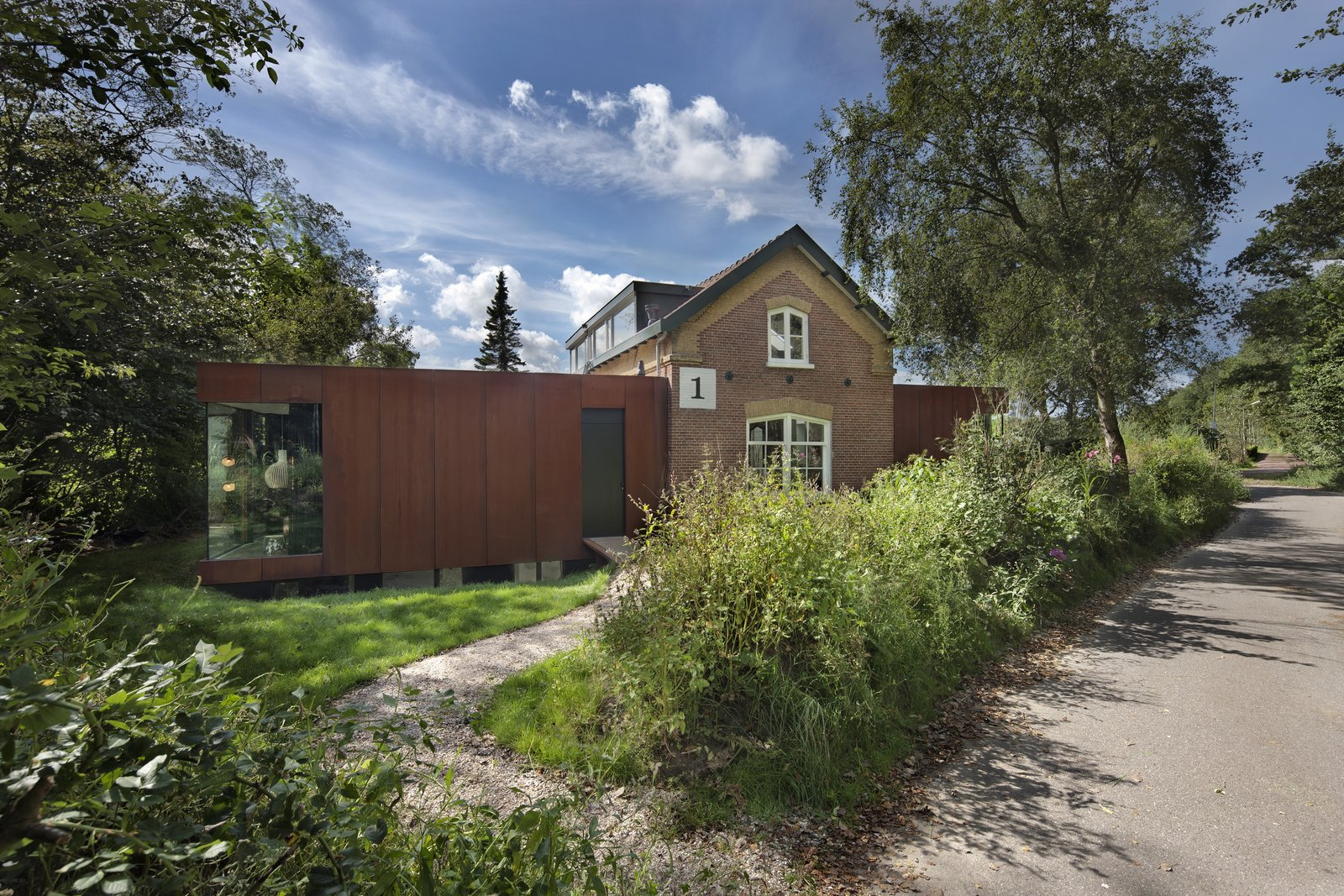 This project by Zecc Architecten BV involved the extension and expansion of a railway cottage dating back to 1867. The home is situated along the train line next to the Sanpoort-Nord station—which is only a 25-minute train ride from Amsterdam—and a national park. The original brick structure was left virtually untouched adding to the charm of the project.  Photo 8 of 17 in A New Book Examines the Art of Breathing Life Into Forgotten Architecture