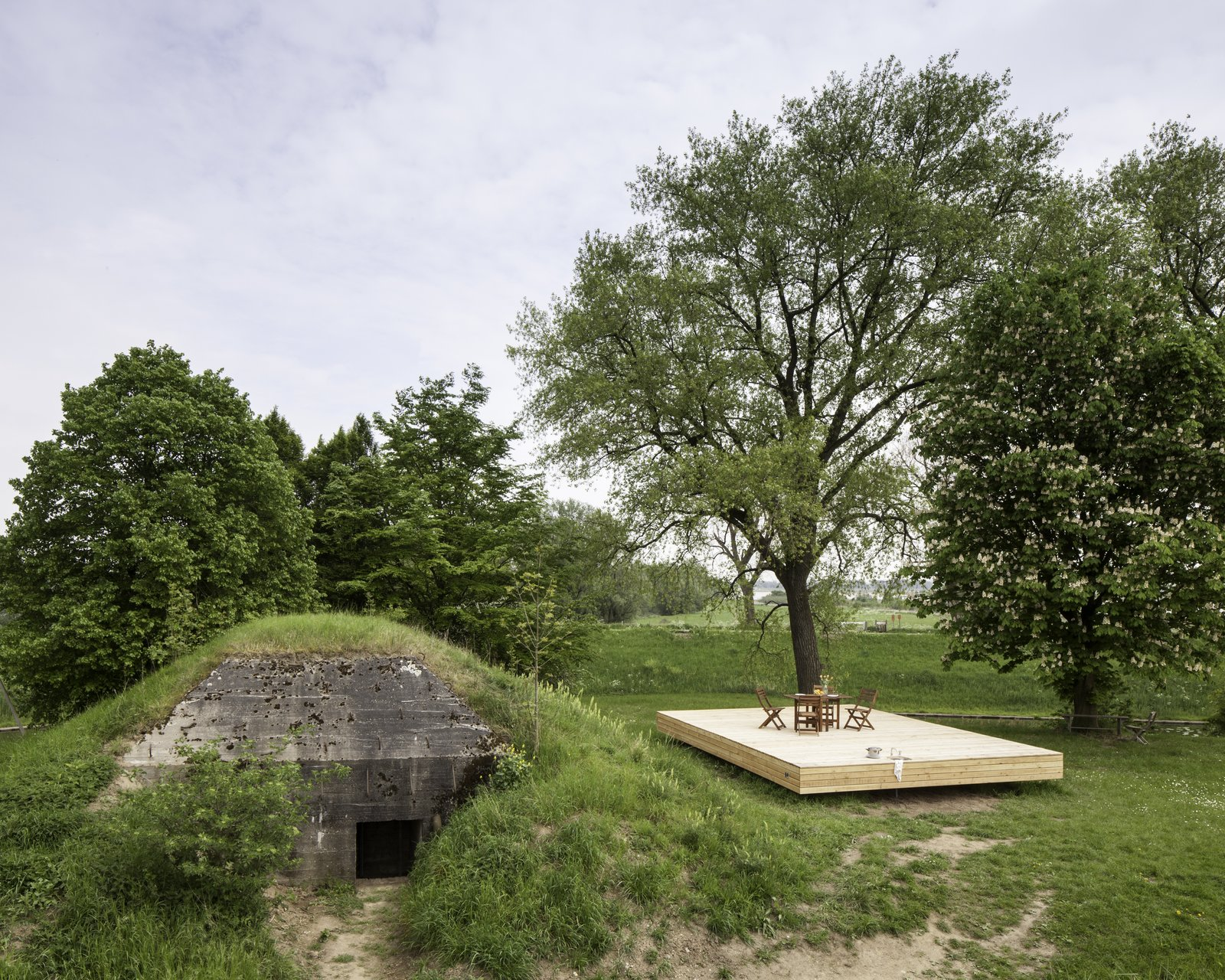 Taking inspiration from Le Cabanon by Le Corbusier—the architectural firm B-ILD conceived of modular wooden fittings which would maximize the potential of the interior space of this Bunker-turned-holiday home in Vuren, The Netherlands.