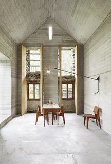 A New Book Examines the Art of Breathing Life Into Forgotten Architecture - Photo 14 of 16 - This Swiss summerhouse is firmly set in the present while being considerate of the structure's 200-year-old past. To preserve the original stone house, Buchner Bründler Architekten created a new concrete one inside of it.