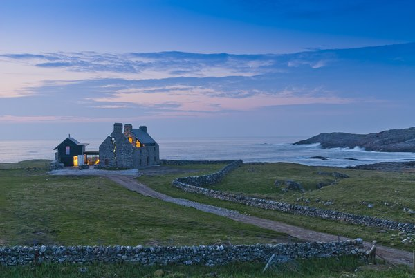 When their clients were unsure whether to renovate this historic ruin on the northern coast of Scotland or build an entirely new house, WT Architecture advised them that by partially occupying the ruin they could actually do both.