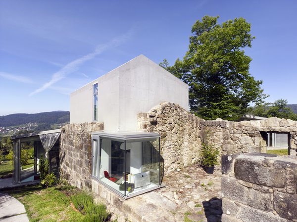 This transformation by Irisarri + Piñera in the northwest province of Pontreveda, Spain is an elegant example of how a ruin can be incorporated into a new contemporary structure while preserving and respecting tradition.