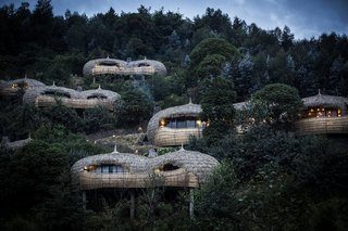 Take an Eco-Escape to a Spherical Forest Villa in an Eroded Volcanic Cone in Rwanda - Photo 9 of 10 - The spherical, thatched structures echo the thousands of hills that dot the Rwandan countryside.