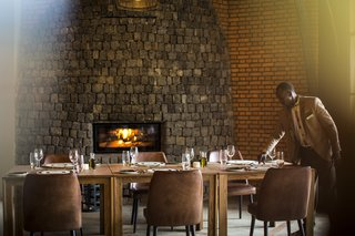 Take an Eco-Escape to a Spherical Forest Villa in an Eroded Volcanic Cone in Rwanda - Photo 7 of 10 - The dining area