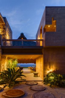 This Expansive Beachside Home on Mexico's Pacific Coast Puts a Modern Spin on Tradition - Photo 2 of 13 - The home features a stunning view of a private beach.