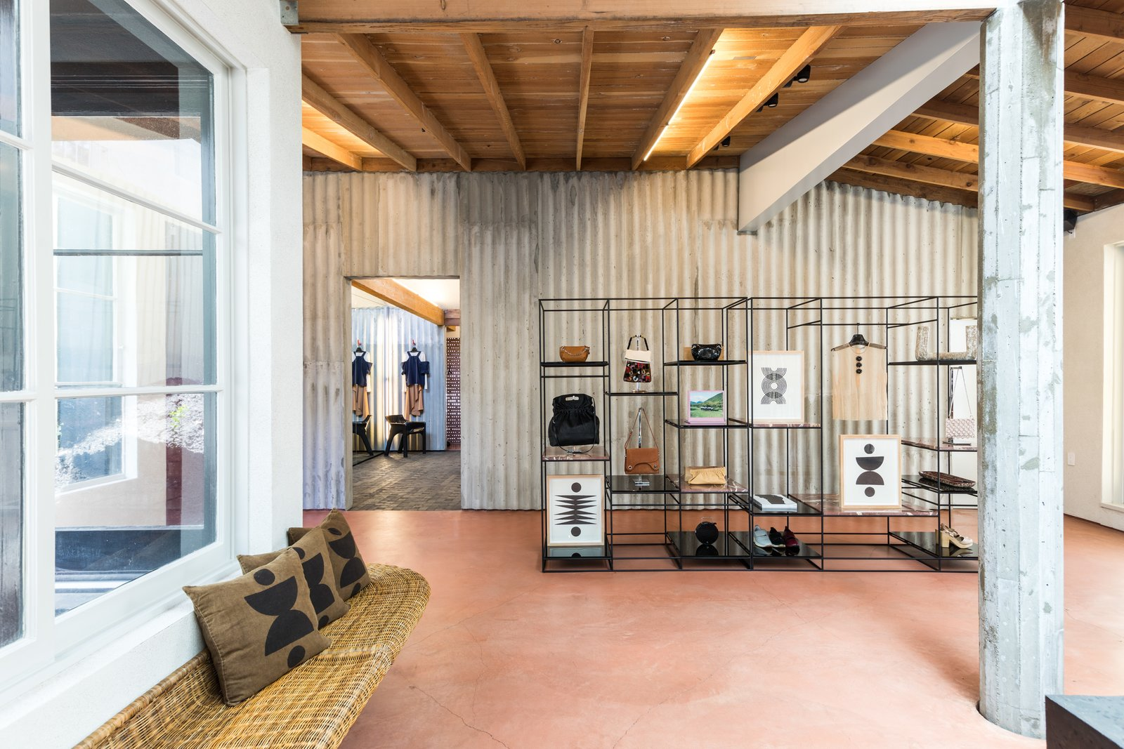 Comey's shop features terra-cotta-colored floors, wood beam ceilings, skylights and a wraparound wicker bench—the perfect setting for Block Shop's new print collection.  Photo 8 of 9 in The Block Shop Sisters Launch Their Framed Woodblock Prints at Rachel Comey's L.A. Boutique