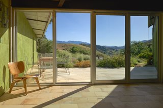Set on 40 Enchanting Acres in Ojai, This Award-Winning Green Residence Is on the Market For $2.2M - Photo 3 of 10 - The patio looks out on Ojai's famous Topatopa Mountain Range.