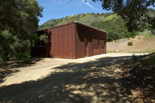 Set on 40 Enchanting Acres in Ojai, This Award-Winning Green Residence Is on the Market For $2.2M - Photo 8 of 10 - A Corten-clad 630-square-foot separate structure houses a two-car garage and an art studio.