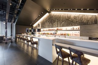Art and Design Come Together in These 10 Examples of Inspirational Wall Murals - Photo 3 of 12 - Another large-scale mural is featured behind the hotel bar.