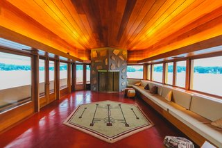 A Home on a Private Island That's Based on a Frank Lloyd Wright Design Is on the Market For $14.9M - Photo 5 of 14 - Large windows wrap around the home's exterior, offering stunning views from every room. It also features six wood-burning fireplaces.
