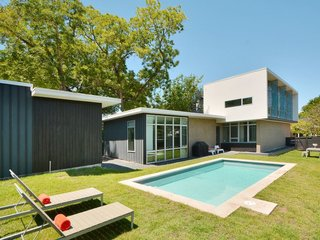 Feel at Home While Exploring Austin at One of These Modern Short-Term Rentals - Photo 6 of 17 - Designed by Austin-based architect Kevin Atler, this customized contemporary home is located in the heart of South Congress (SoCo) and features a grassy backyard with a pool.