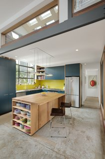 A 1960s Melbourne Warehouse Is Upcycled and Transformed Into an Energy-Efficient Family Home - Photo 3 of 11 - The open kitchen features custom cabinetry and a recycled timber island.