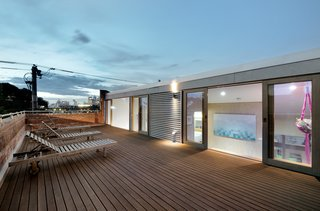 A 1960s Melbourne Warehouse Is Upcycled and Transformed Into an Energy-Efficient Family Home - Photo 11 of 11 - The home's roof-deck offers stunning views of the Australian city.