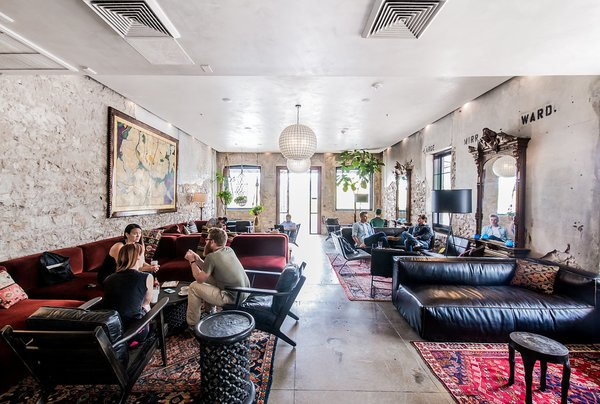 "A New Experiential Hostel in Austin Offers Unique Lodging in a Restored Railway Hotel - Photo 2 of 16 - A cafe and parlor offers a co-working space for both guests and locals during daytime hours. <span style=""color: rgb(204, 204, 204); font-size: 13px;"">Casey Chapman</span>"