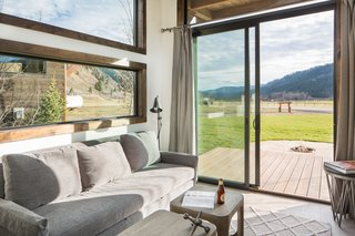 Test Out Tiny House Living at One of These Nature-Immersed Cabin Resorts - Photo 11 of 14 - Sliding doors open to a deck offering incredible views of the local landscape.