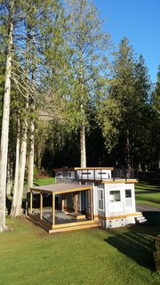 Test Out Tiny House Living at One of These Nature-Immersed Cabin Resorts - Photo 14 of 14 - The Flat Roof Caboose design features a loft that can accommodate two beds. Windows give the loft area an open-air feel with an abundance of light. The front of the cabin opens to a private deck. Exteriors are covered with a mix of metal and wood-tone siding for a contemporary finish.