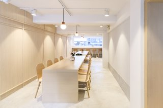 A Sleek Coffee Shop in Hong Kong With Beautiful, Minimalist Interiors - Photo 7 of 9 - The second floor features two communal tables that can be pushed together to form one long table for special events.