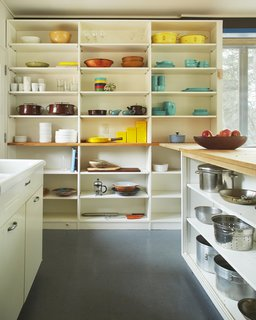 Experience Cape Cod Modern by Staying at the Midcentury Weidlinger House - Photo 7 of 8 - The kitchen's open shelving serves as a colorful display for midcentury-modern cookware.