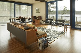 Experience Cape Cod Modern by Staying at the Midcentury Weidlinger House - Photo 5 of 8 - The home is perched above the pond and features panoramic views of the natural surroundings.