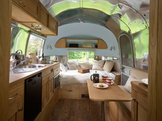 Live the Airstream Life Vicariously With a New Book That Celebrates the Timeless Trailers - Photo 8 of 19 - The beautiful interior of this Caravel was created by ARC Airstreams.