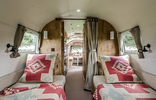 """Live the Airstream Life Vicariously With a New Book That Celebrates the Timeless Trailers - Photo 9 of 19 - The design brief for this 1964 Airstream Overlander restored by ARC Airstreams was """"luxury with a country feel."""" Ralph Lauren's Corral Canyon fit the bill."""
