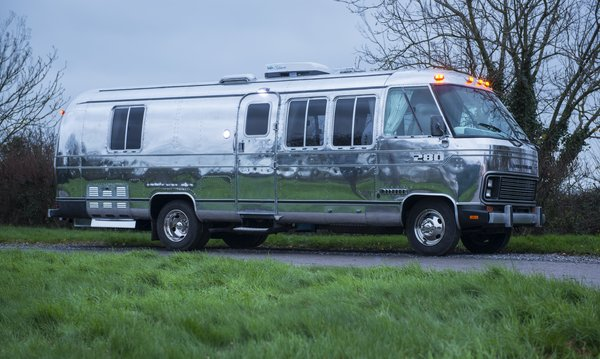 This stunning renovation of an Airstream Motorhome was created by professional Airstream designers American Retro Caravans.