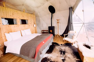 Go Eco-Friendly Glamping in These Geodesic Domes in the Swiss Alps - Photo 3 of 10 - All the pods are equipped with organic luxury bedding and efficient pellet stoves, which add to the cozy interiors.