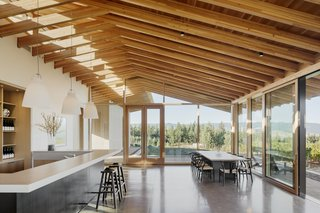 6 Modern Wineries on the West Coast With Beautiful Architecture - Photo 4 of 17 - Two large sliding doors centered with the tasting room bar bring the vineyard into the space, while also serving as a passive cooling system in the summer when used in tandem with the upper clerestory windows.