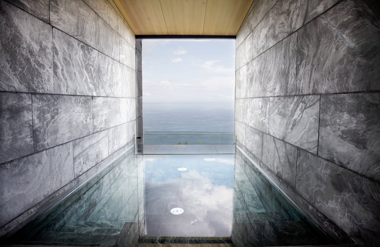 The wellness area is divided into two areas: a wet zone with a stone swimming pool, sauna, and a Turkish bath; and a separate zone for spa treatments.