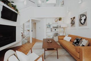 This Tree House For Rent Near Downtown Portland Doubles As an Art Platform - Photo 5 of 14 - The airy living room features high ceilings and a cozy fireplace.
