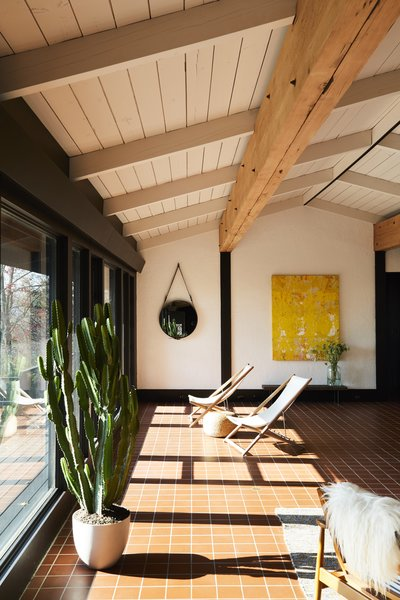 The home features silent and cozy radiant floor heating—a very forward-thinking feature—and there is not a single heating vent or visible outlet in sight.