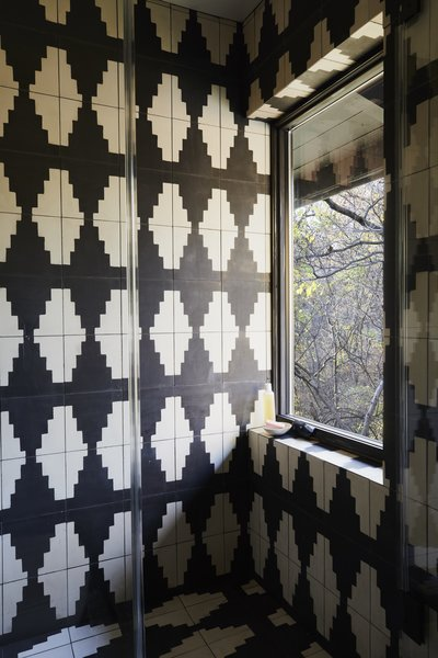Graphic black and white cement tile was added in the renovation.
