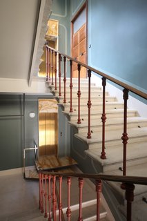 This Venetian Apartment Is Bursting With Incredible European Furnishings - Photo 4 of 23 - The staircase features milled-eucalyptus wood and was designed by Marcante-Testa and built by Materia Design.
