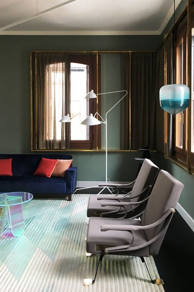 This iconic floor lamp from Serge Mouille alongside the Flow S4 Pendant, designed by Nao Tamura, inspired by the reflections of the Venetian cityscape, are both stylish standouts.